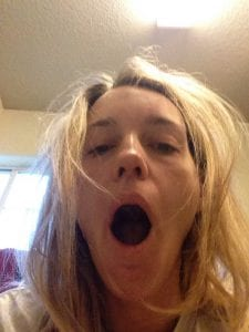 Woman yawning from being tired