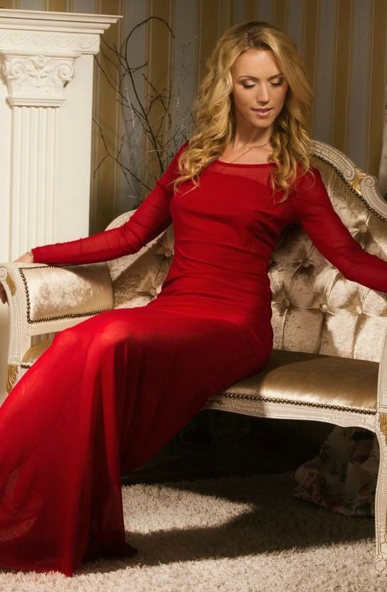 that skinny red dress on a girl sitting on a couch