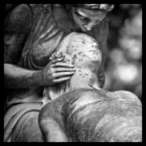 a statue of a girl comforting someone