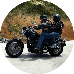 Laura and Jason riding on a harley in new zealand