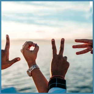 4 hands gesturing love and peace
